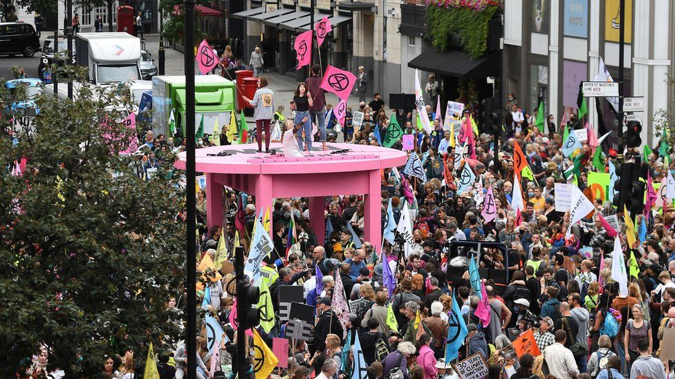 large pink table surrounded by crowds