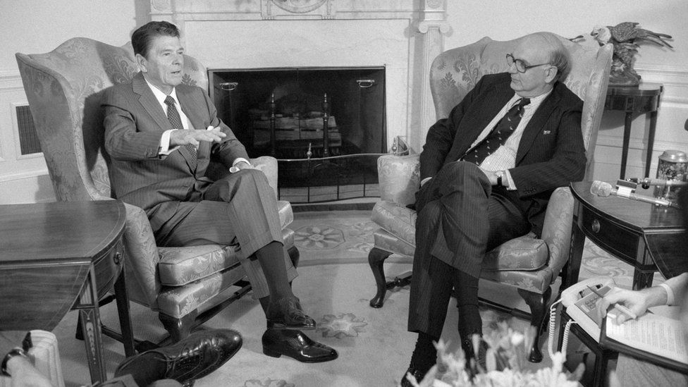 President Reagan talks with Federal Reserve Board Chairman Paul Volcker in the Oval office.
