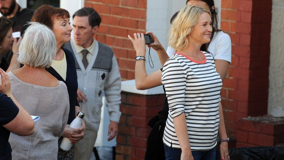 Melanie Waters and Joanna Page pose for pictures as Rob Brydon looks on