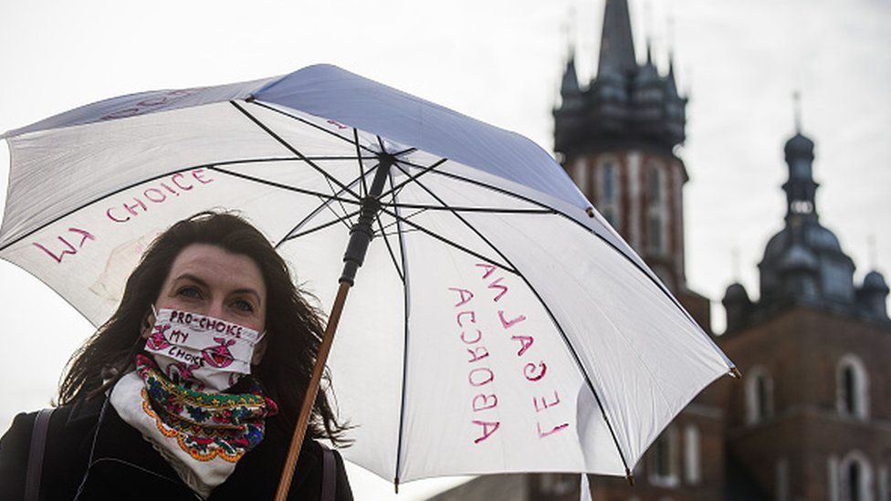 A pro-abortion activist takes part in a demonstration in Krakow in April 2020