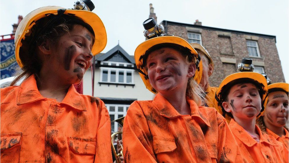 Youngsters dress up as miners at the Durham Miners' Gala