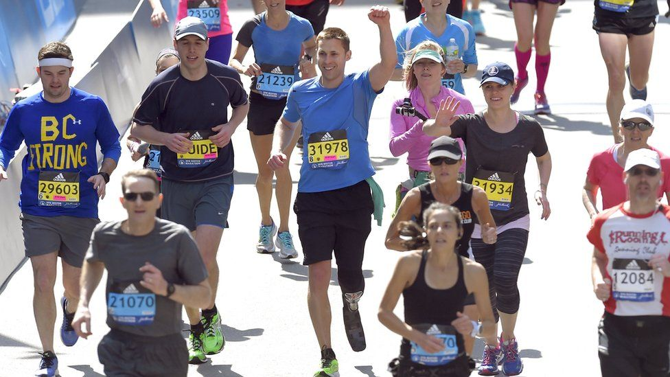 Patrick Downes finishing the Boston marathon