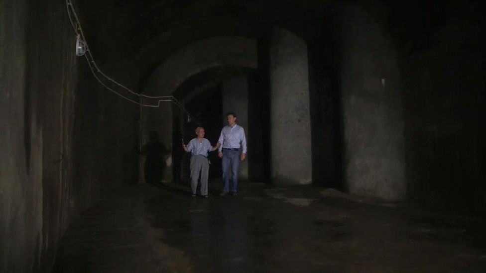 Su and Rupert Wingfield-Hayes in a tunnel