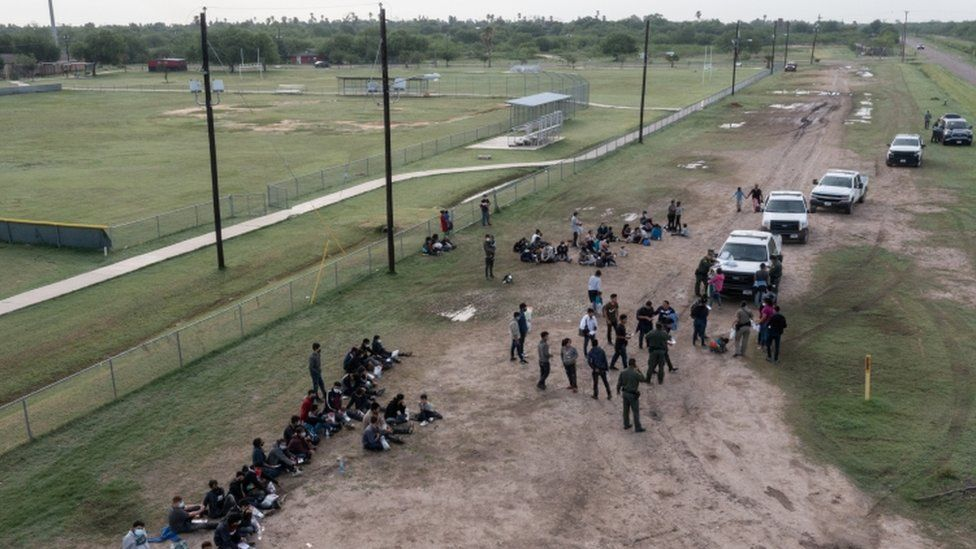 Asylum seeking unaccompanied minors from Central America are seen on the left in this aerial image after crossing the Rio Grande river into the United States from Mexico in La Joya, Texas, U.S., May 14, 2021
