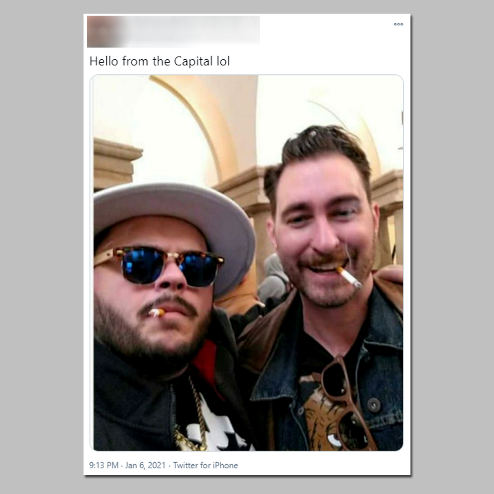 """The individual on the right is Nick Ochs, who describes himself as a """"Proud Boy Elder""""."""