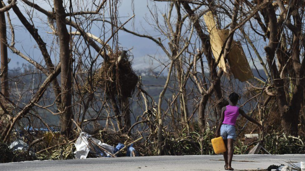 A girl carries water in Port-Salut, southwest of Port-au-Prince, in Haiti, on October 9, 2016