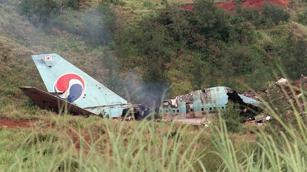 Smokes rises from the wreckage of a South Korean Air Boeing 747 at the crash site at Agana in Guam, 6 August 1997