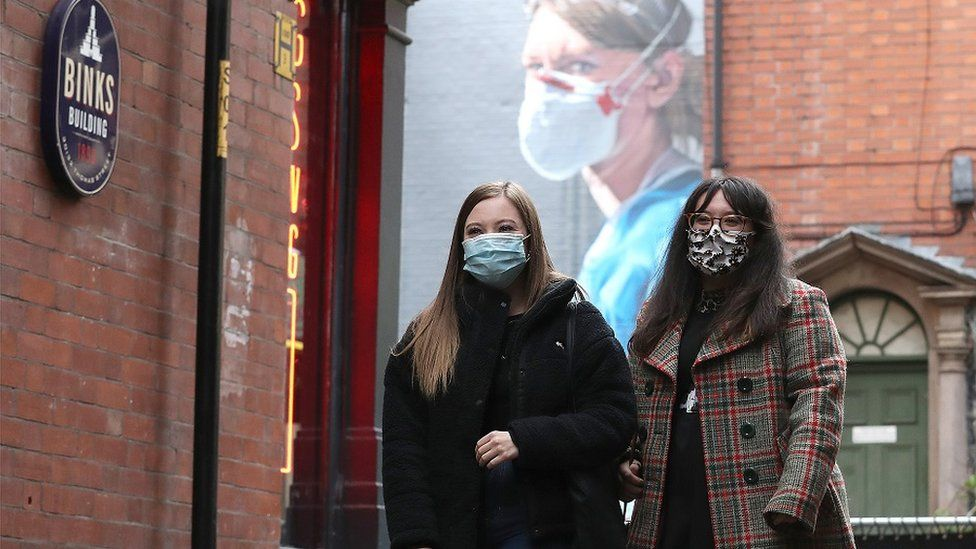Two women in face coverings in Manchester