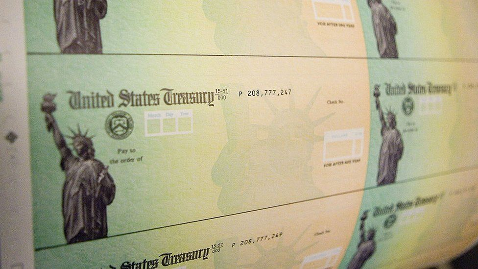 Economic stimulus checks are prepared for printing at the Philadelphia Financial Centre