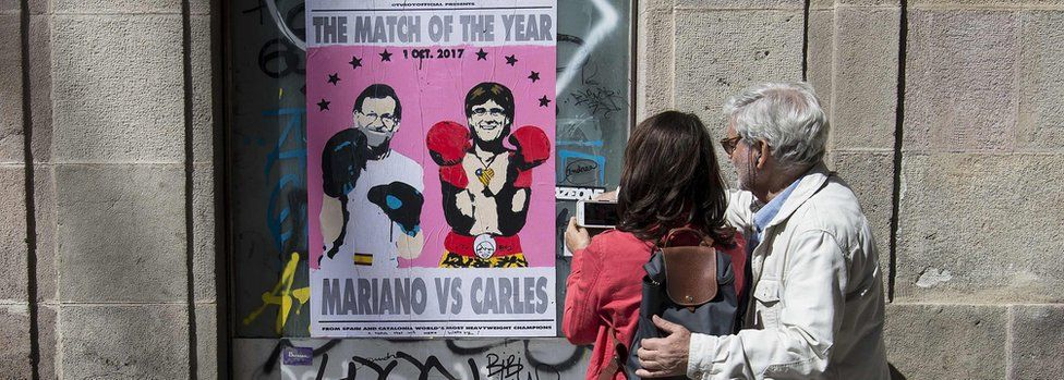 A poster showing Spanish Prime Minister Mariano Rajoy (L) and President of the Catalan Government Carles Puigdemont, on September 16, 2017 in Barcelona