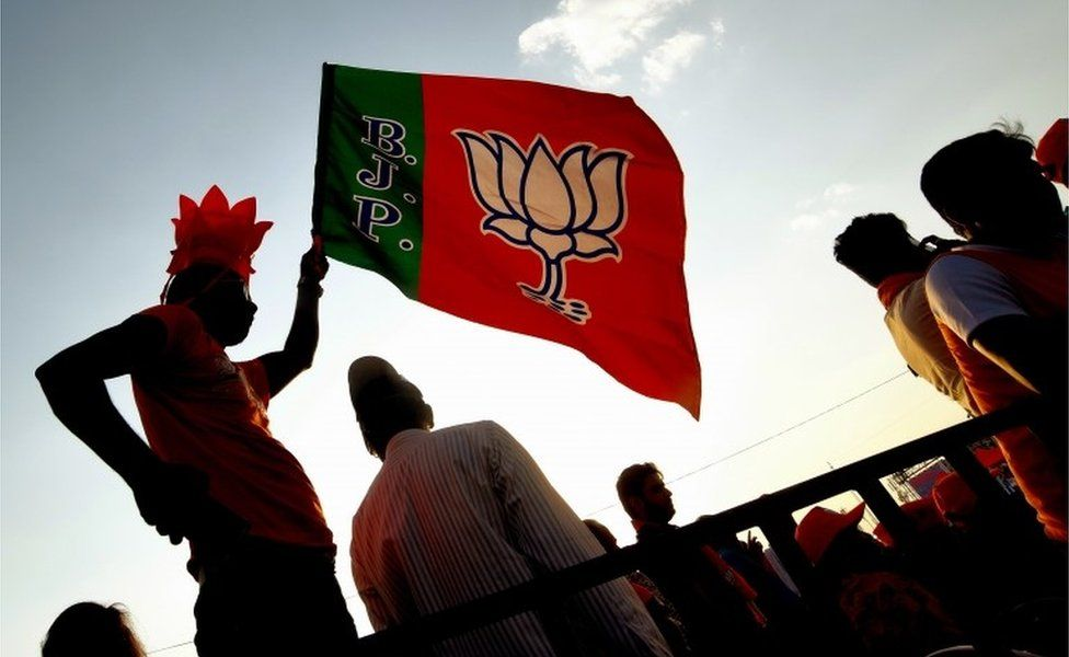 A supporters waves the party flag, during the Bharatiya Janata Party (BJP) election rally meeting in Bangalore, India, 13 April 2019