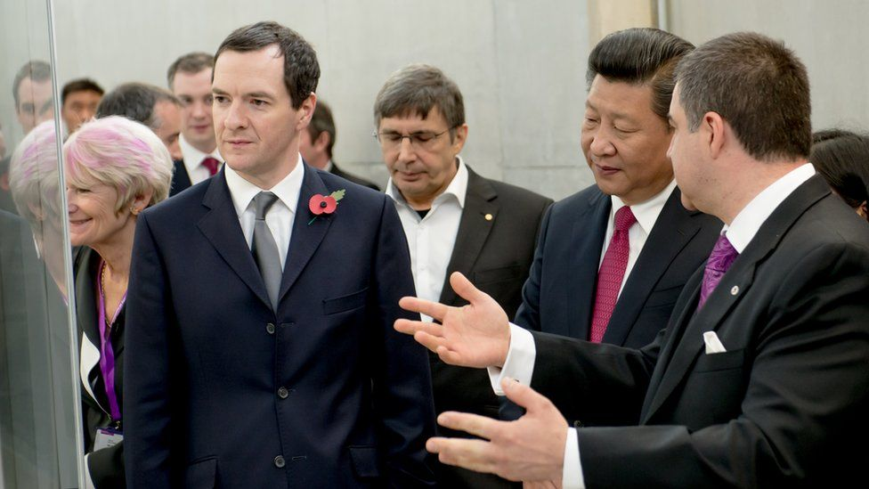 The then Chancellor of the Exchequer George Osborne (L) and the President of the People's Republic of China Xi Jinping at the National Graphene Institute at Manchester University on October 23, 2015 in Manchester
