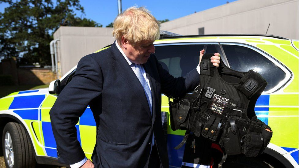 Boris Johnson examining a police vest