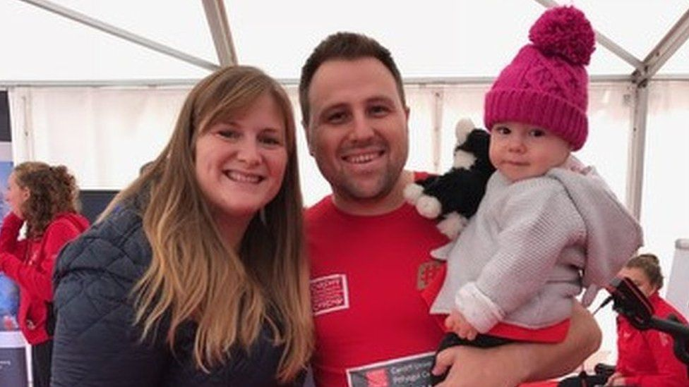 Dean Fletcher with wife Katie and their daughter Evie posed for a picture before the race