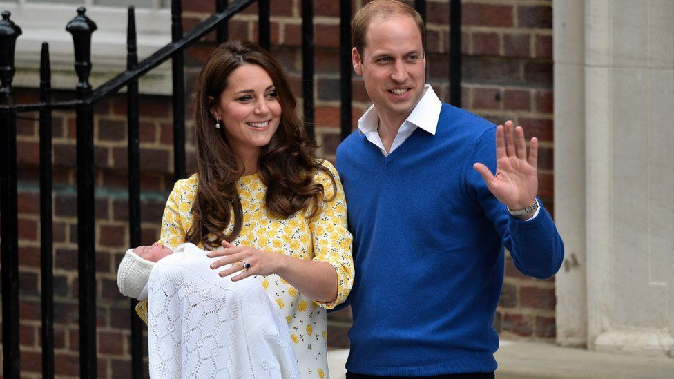 Prince William, Duke of Cambridge, and his wife Catherine, Duchess of Cambridge pose with their newborn daughter outside the Lindo Wing at St. Mary's Hospital in Paddington in 2015