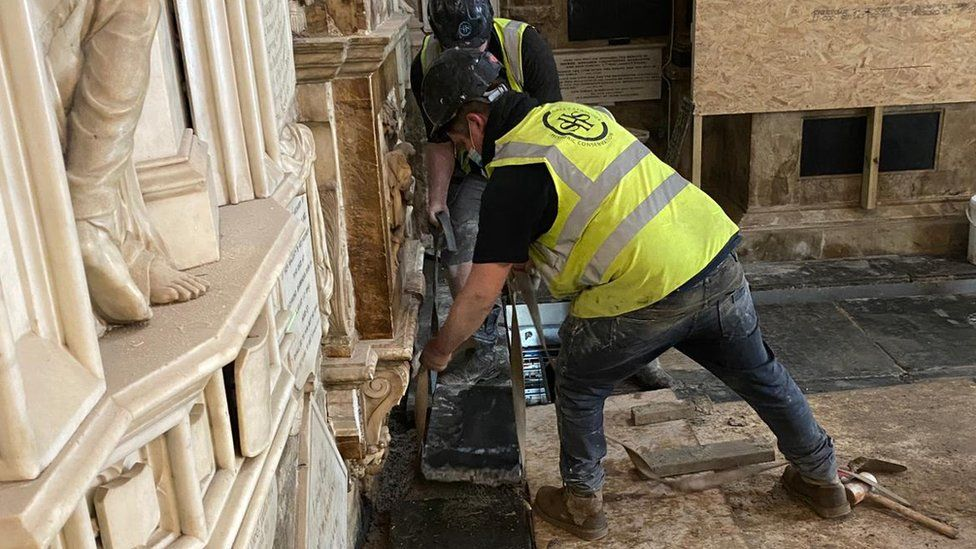 the final stone is installed in the restoration of Bath Abbey's historic floor