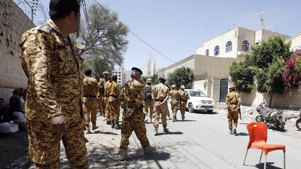 Houthi security forces outside the headquarters of the UN migration agency in Sanaa, Yemen (13 March 2021)