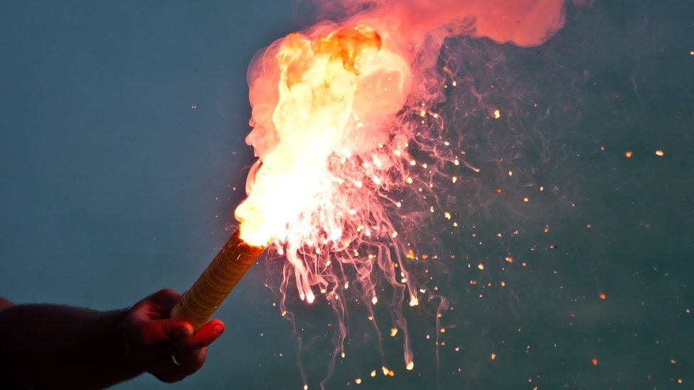 An ignited safety flare