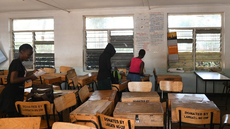 School children pack their books to take home, following a directive by the Kenyan government to suspended learning