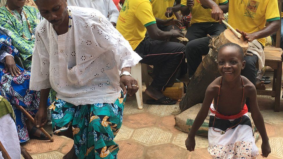 voodoo followers dance during a cleansing ceremony in Ouidah