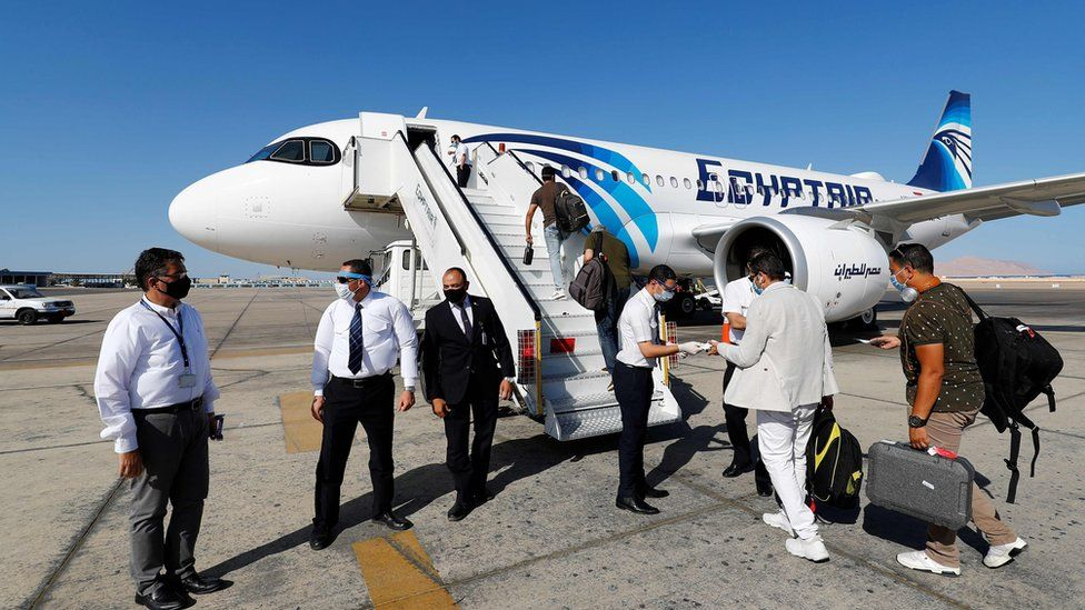 EgyptAir crew check the documents of travellers at Sharm el-Sheikh international airport (20 June 2020)