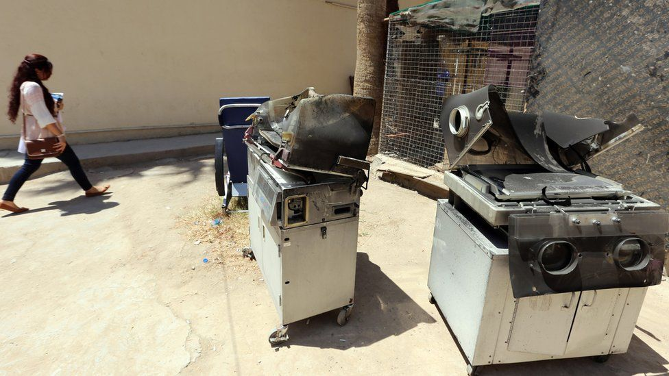 Burnt incubators outside the Yarmouk Hospital in Baghdad after a fire that killed 12 babies (10 August 2016)