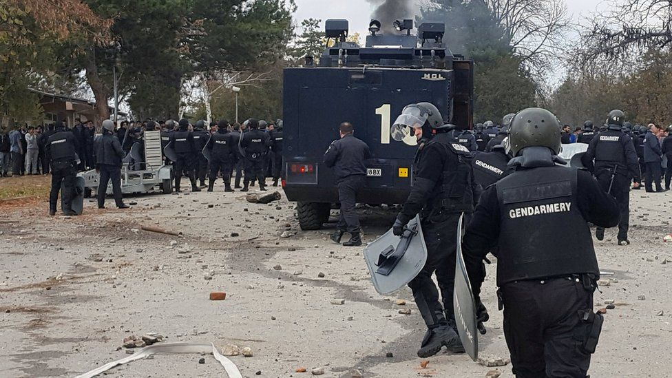 Bulgarian riot police are seen during clashes in the migrants reception centre in the town of Harmanli