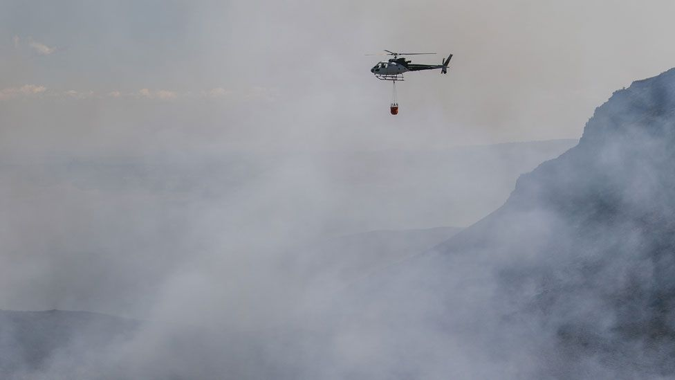 helicopter carrying water