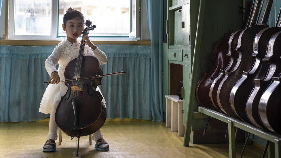 Girl plays a cello