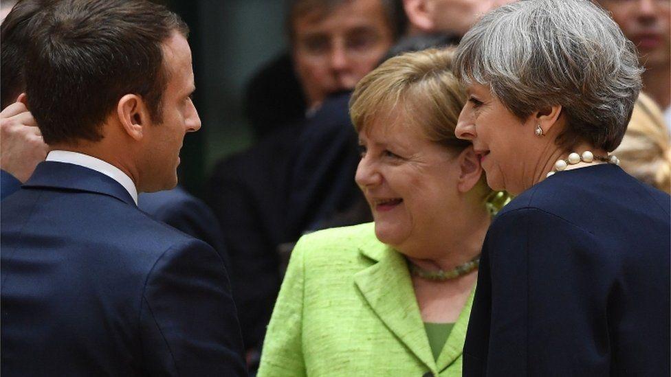 Theresa May with Angela Merkel and Emmanuel Macron at the summit