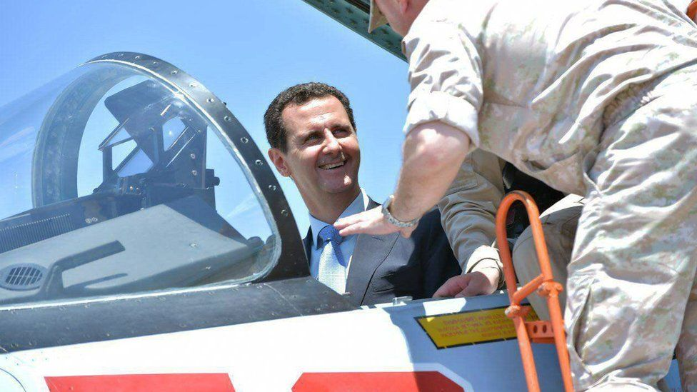 President Bashar al-Assad sits inside a Su-27 jet during a visit to the Hmaimim military base in Latakia province, Syria (27 June 2017)