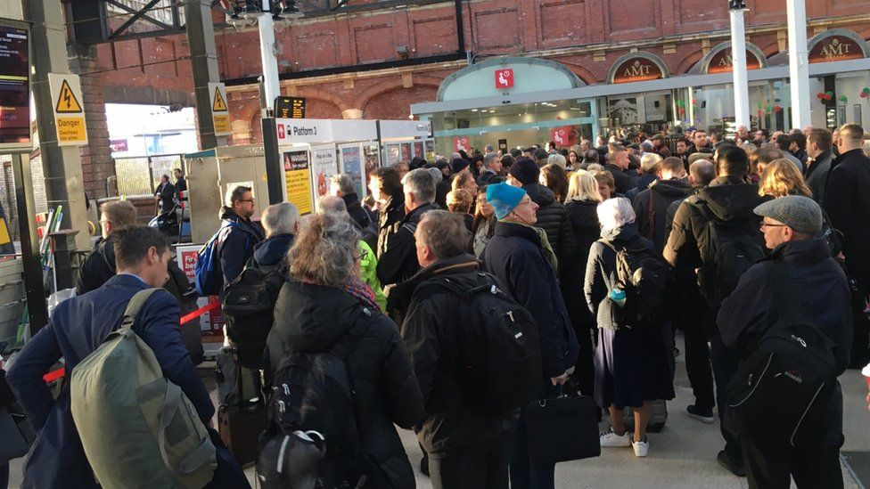 Passengers at Norwich railway station after a train cancellation