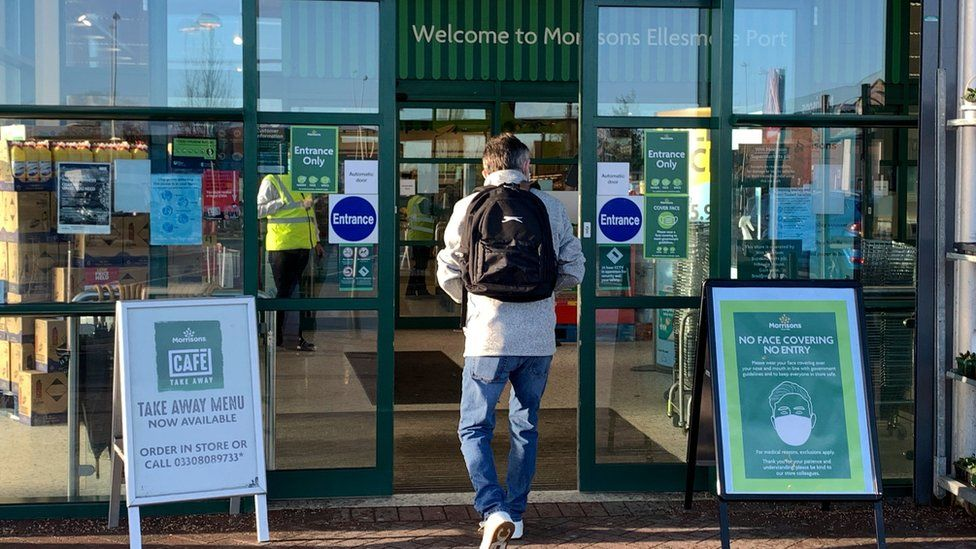 Person going into Morrisons store