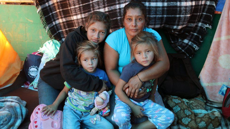 Maria Meza with her three daughters