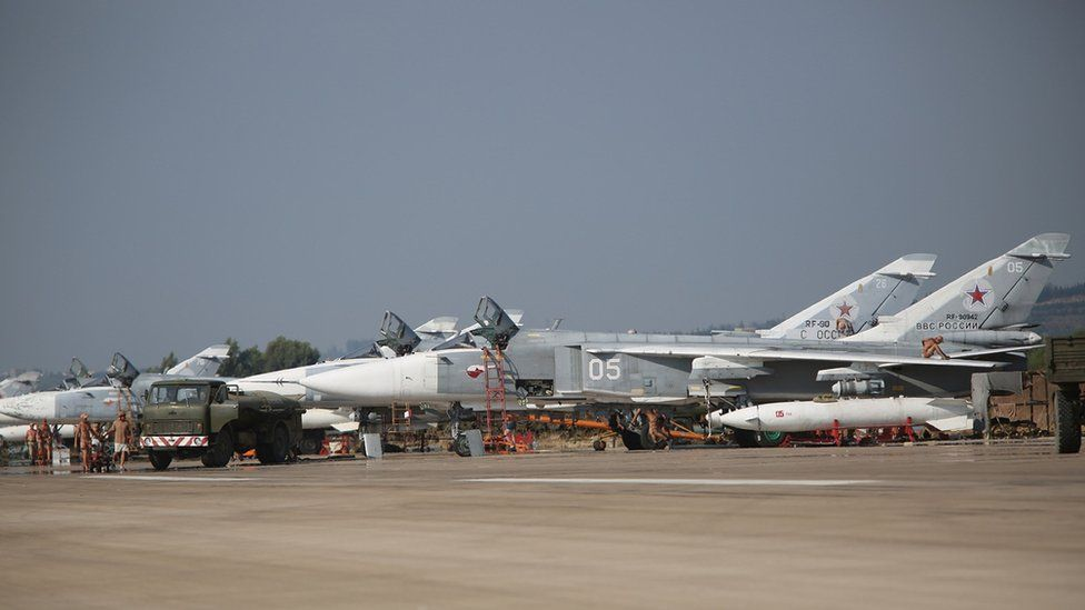 Russian Sukhoi SU-24 bombers standing on an airfield at the Hmeimim airbase in the Syrian province of Latakia