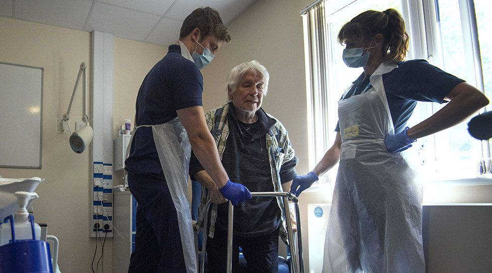 Hospital staff carry out physiotherapy