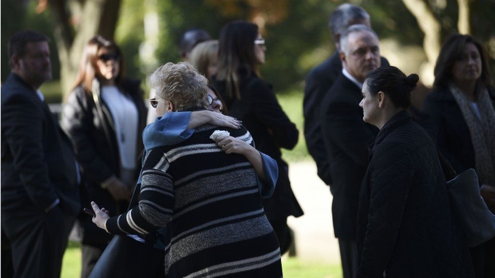 Women embrace as they arrive outside the Rodef Shalom Congregation where the funeral for shooting victims Cecil Rosenthal and David Rosenthal will be held