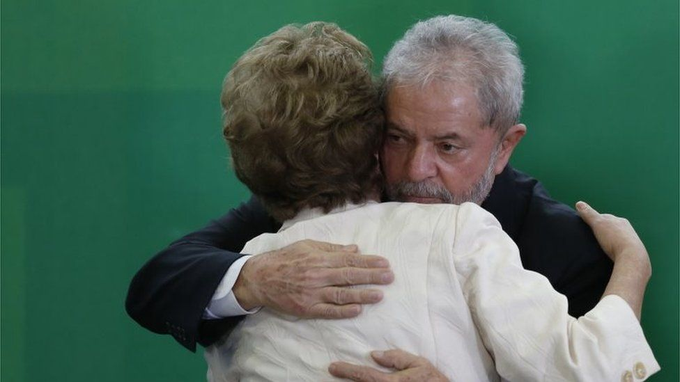 Brazil's former president, Luiz Inacio Lula da Silva hugs Brazil President Dilma Rousseff as he is sworn in as the new chief of staff in the Planalto Palace on March 17, 2016 in Brasilia, Br