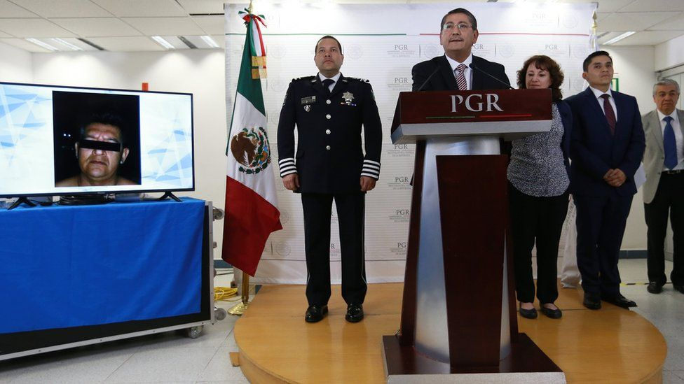 A picture released by the prosecutor's office shows Alfredo Higuera speaking to the press