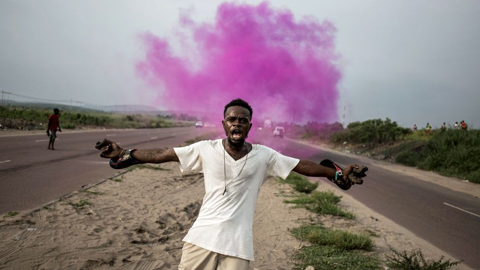 A supporter of Democratic Republic of Congo opposition leader Martin Fayulu reacts after police fire teargas in Kinshasa, DR Congo - 19 December 2018