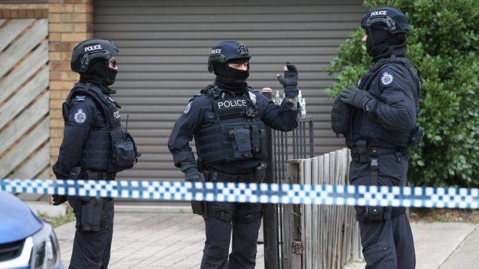 Heavily armed police officers involved in raids in Melbourne on Tuesday