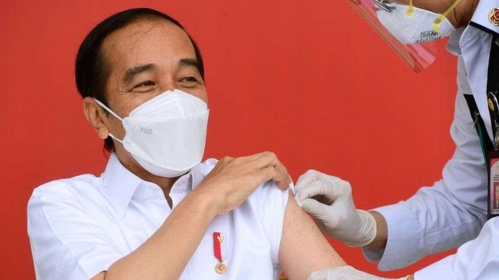 President Joko Widodo reacts after receiving a shot of COVID-19 vaccine at the Merdeka Palace in Jakarta, Indonesia, January 13, 2021.