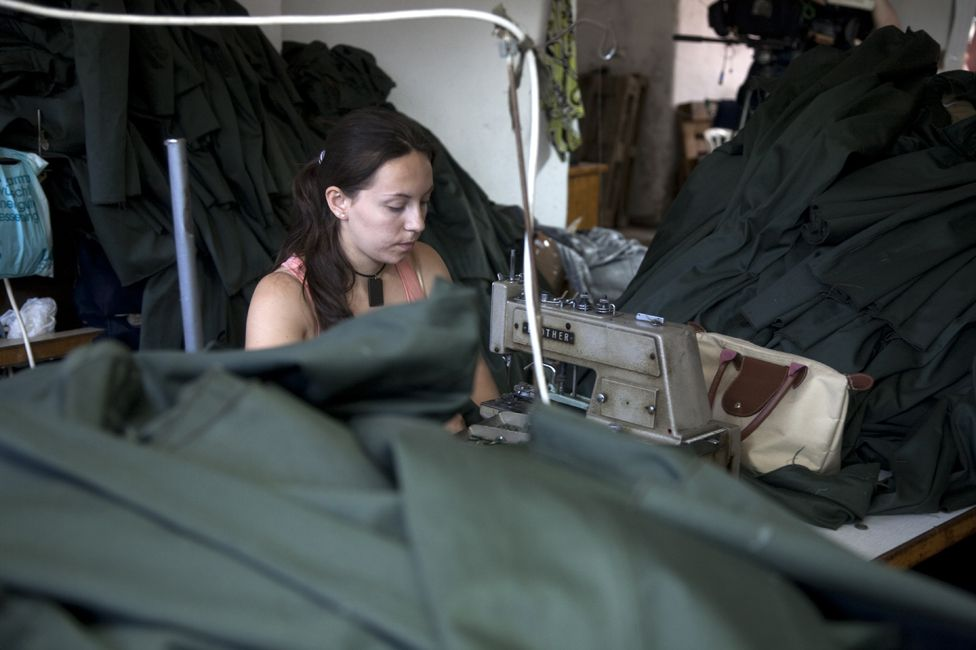 A workshop in Albania producing uniforms for the Greek military