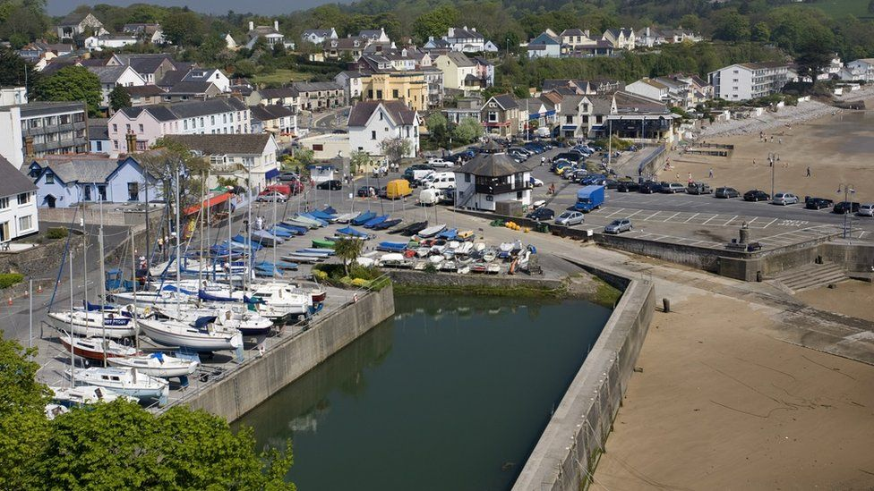 A view of Saundersfoot town, harbour and beach