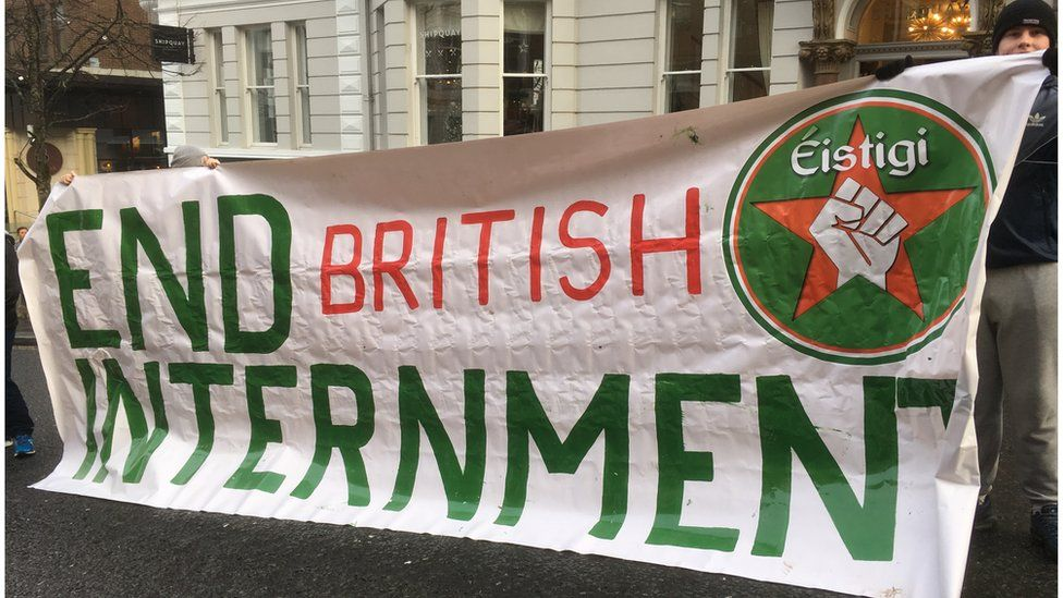 Dissident protesters holding a banner which reads 'End british internment'