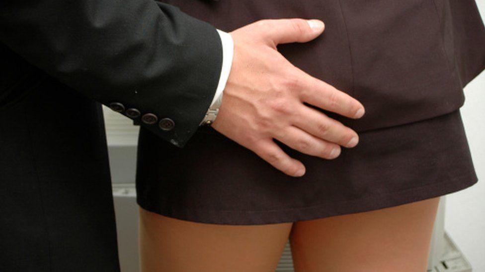 Man touching woman