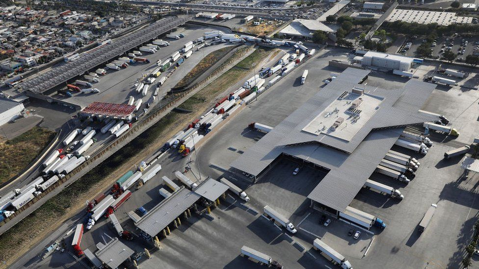 An aerial view of trucks queuing to cross from Mexico into California at the Otay Mesa port of entry on May 11, 2017 in San Diego, California