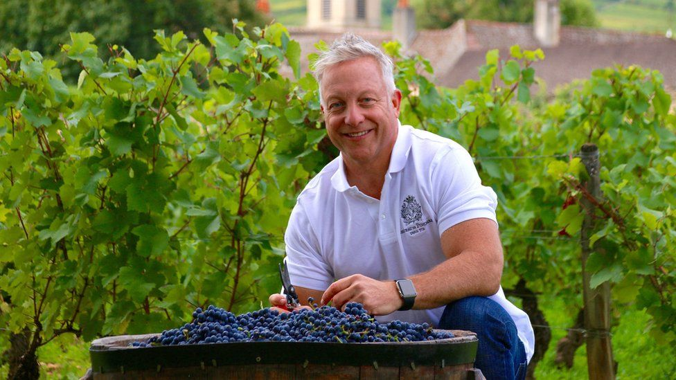 Michael Baum with a barrel of grapes