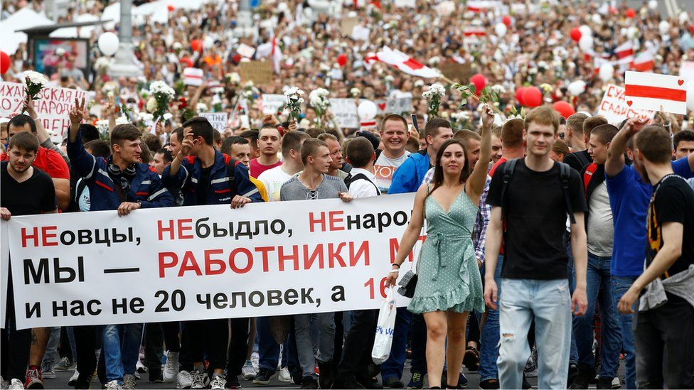 """The banner reads: """"Not sheep. Not a herd. Not the little people. We are workers of MTZ (Minsk Tractor Plant)"""""""