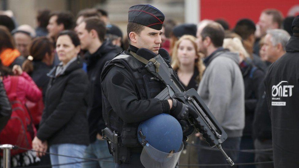 Policeman outside Louvre museum - 17 November